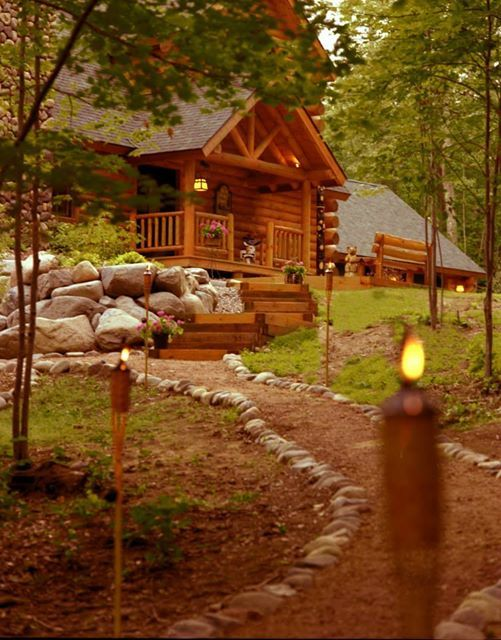 rock lined path to log cabin