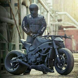 blacked out bike and biker