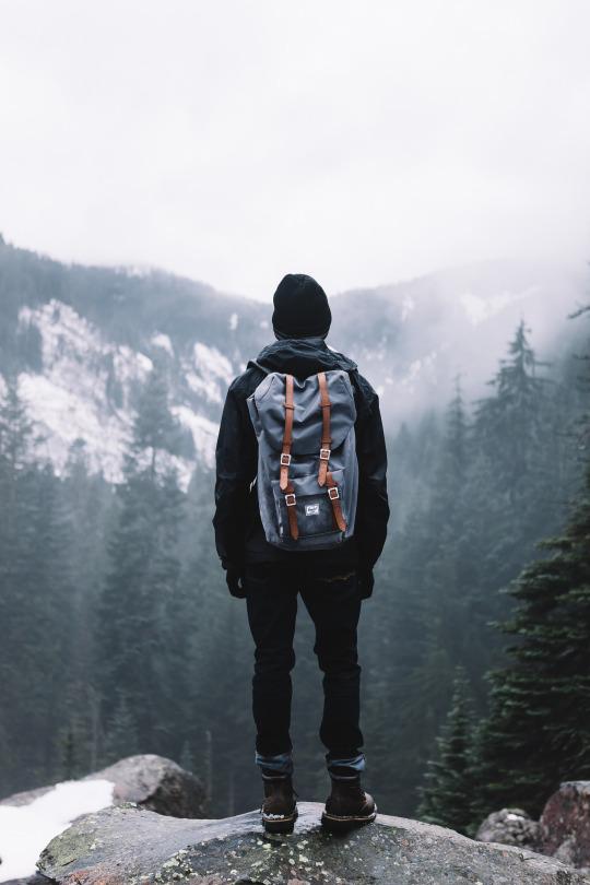 man on edge of cliff
