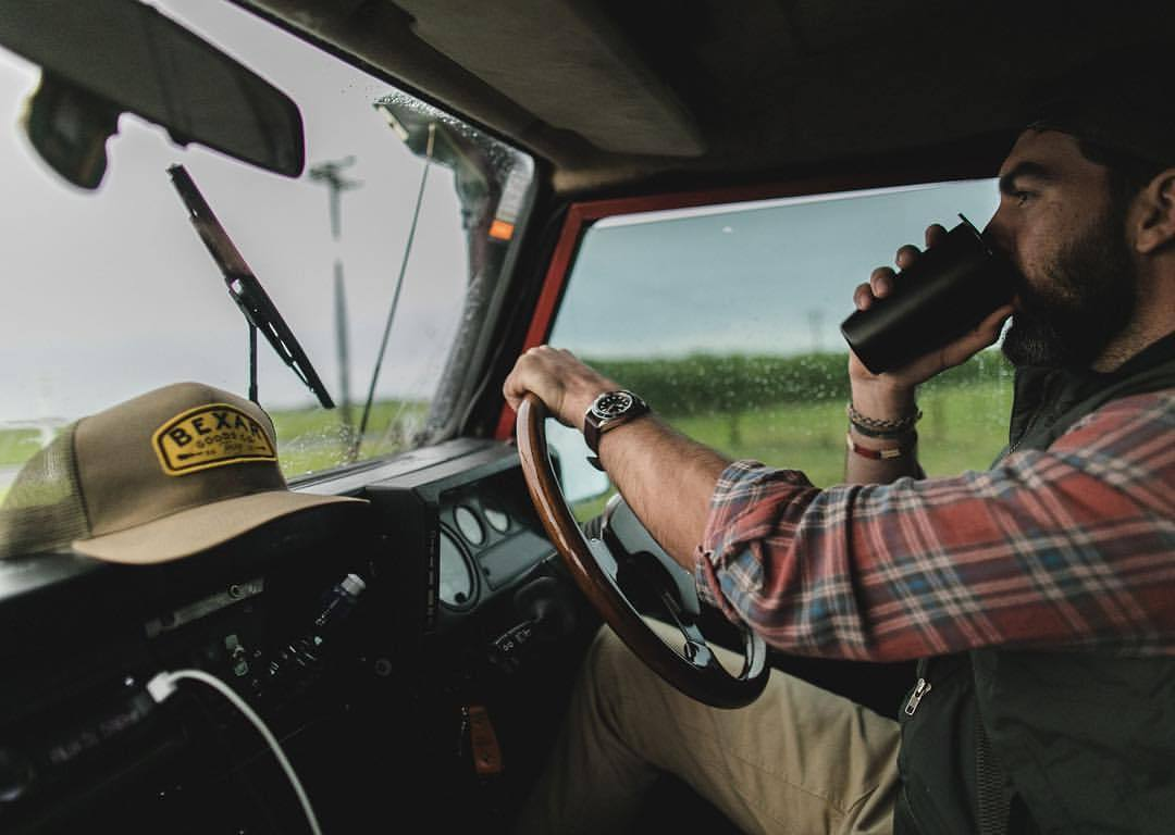 man driving to work in truck