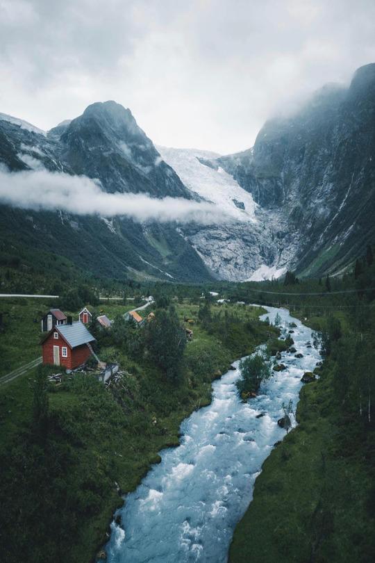 mountain home next to river