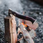 splitting firewood with ax