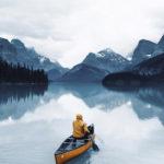 man paddling alone