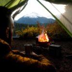 man in tent having zen moment