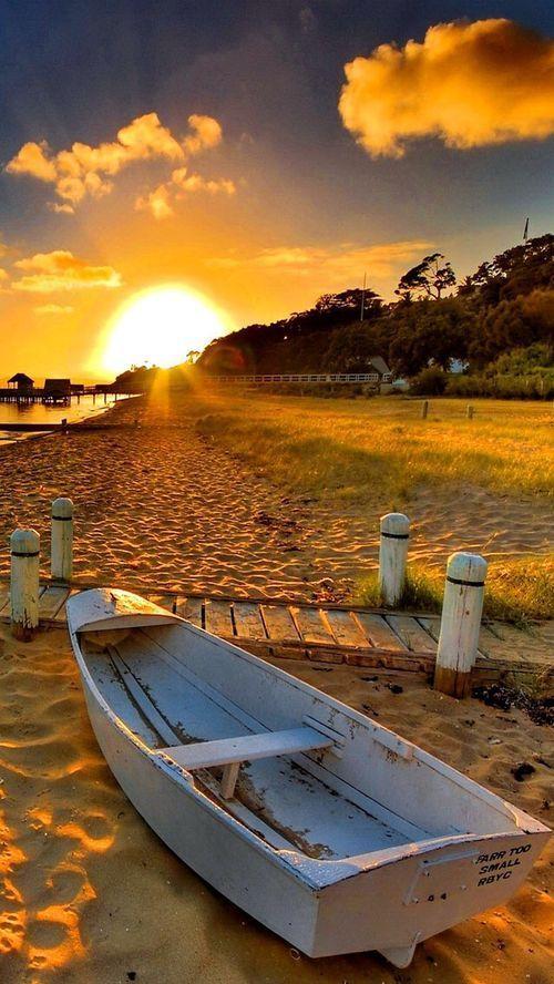 rowboat beach sunset