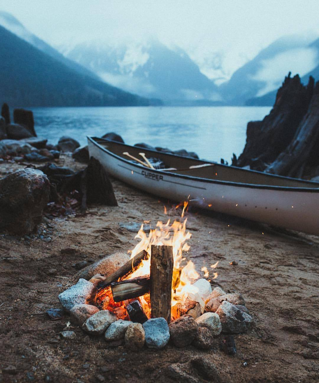 campfire with canoe