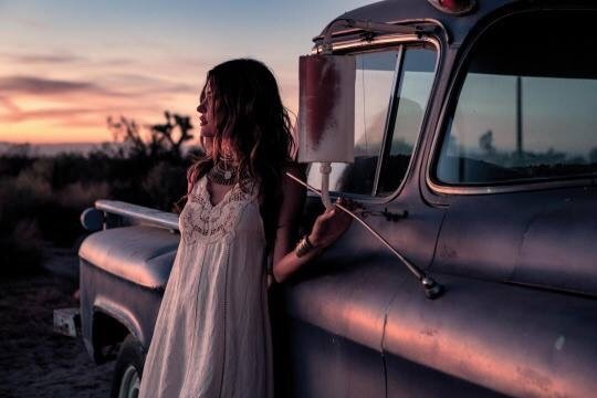 woman next to old pickup truck