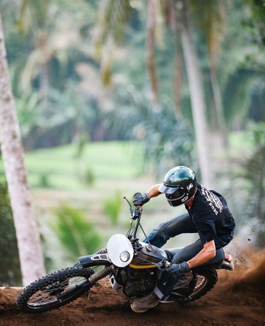 man going around corner on dirt bike