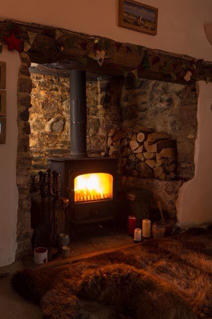 cozy wood burning stove in cabin