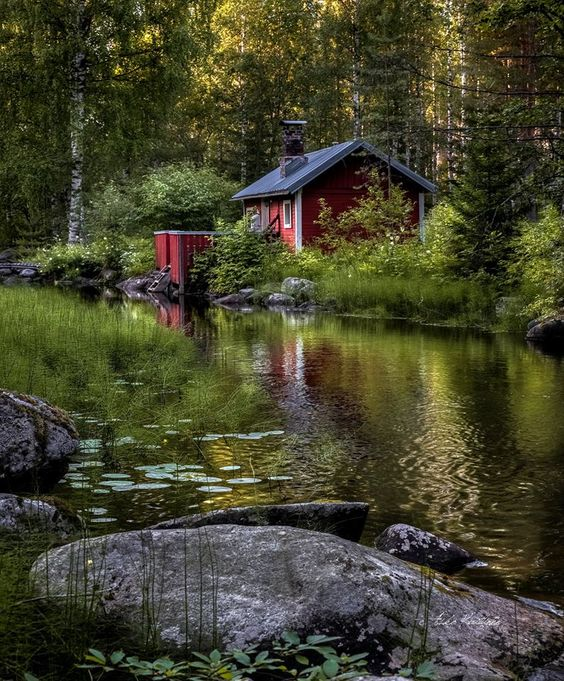 red cabin near stream