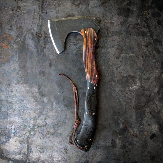 sturdy ax with nice wood grain handle