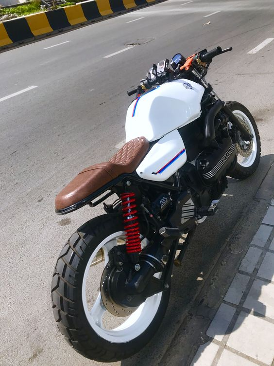white bmw motorcycle with brown leather trim