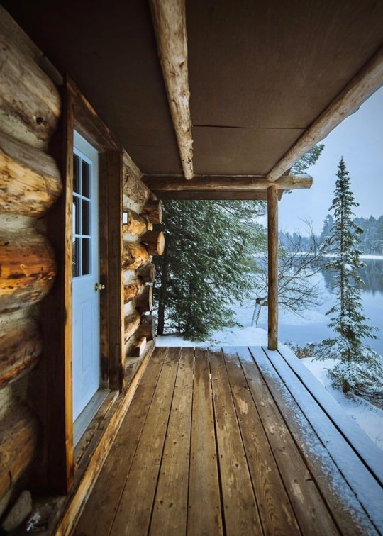 cabin porch with snow