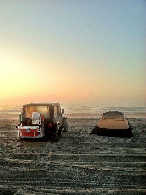 jeep next to tent on beach