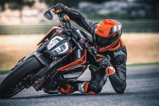 man taking corner on motorcycle