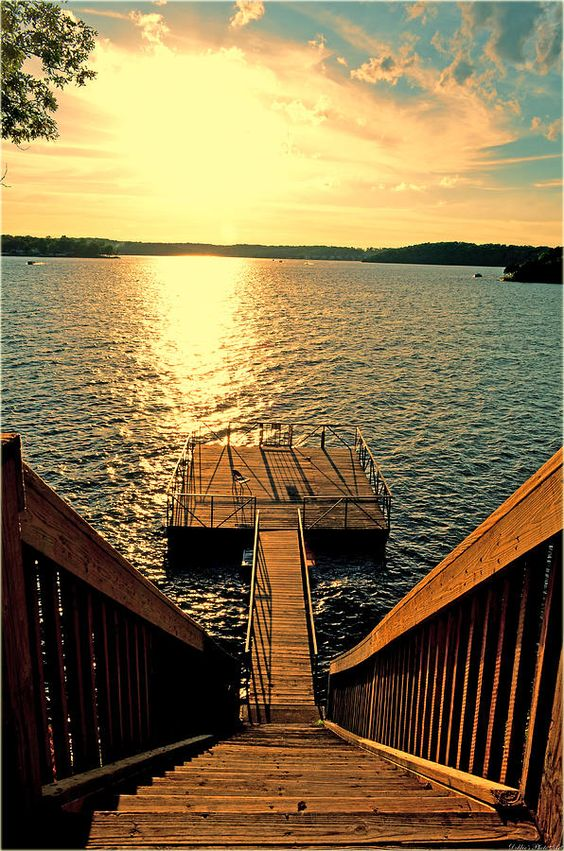 stairs leading to dock on lake