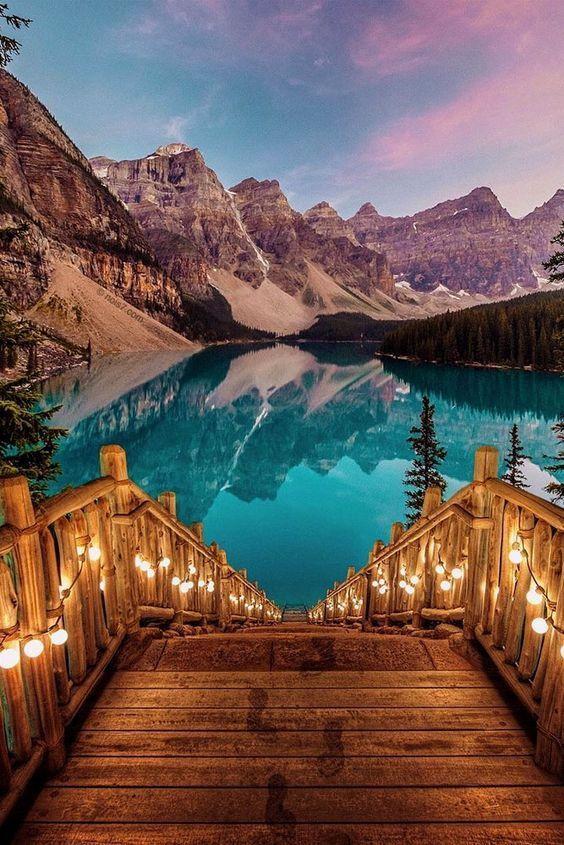 lighted walkway leading to mountain lake