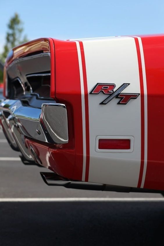 r-t badge on rear quarter panel of muscle car