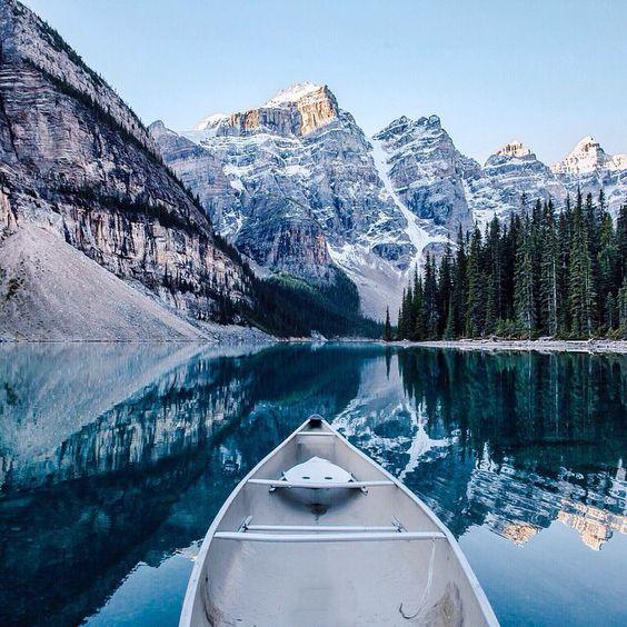 canoeing through mountain lake in winter