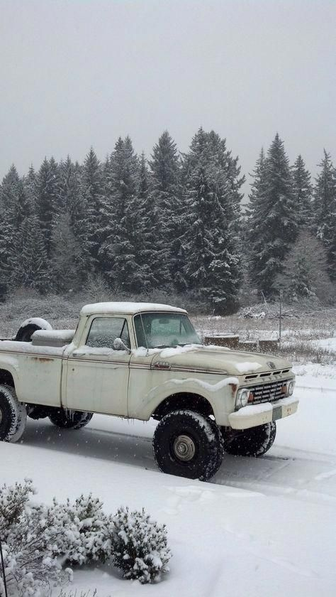 classic pickup truck in the snow