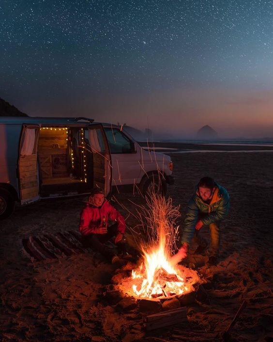 two men camping on the beach