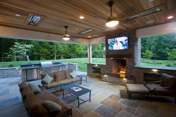 outdoor entertaining room with tv and bbq