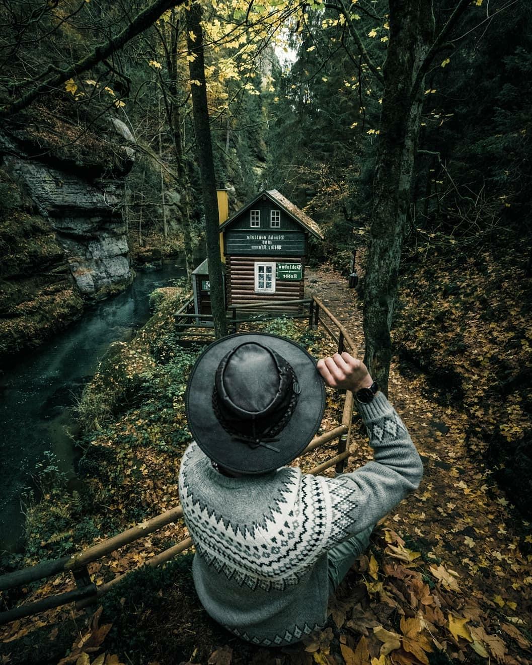 man near cabin
