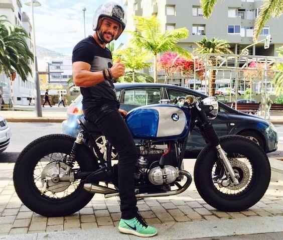 man sitting on bmw motorcycle