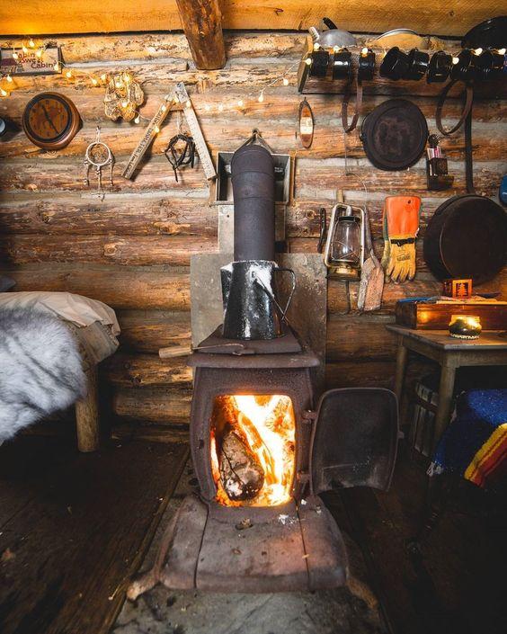 wood burning stove in log cabin