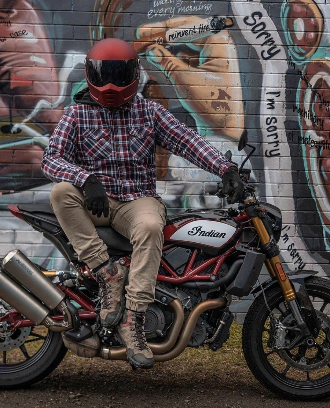 man sitting on indian motorcycle