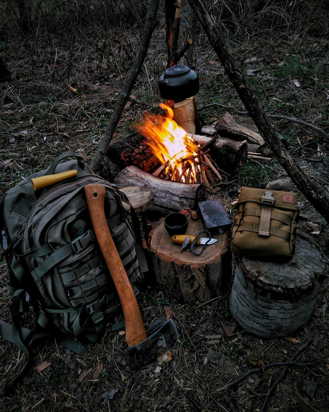 camping gear around fire