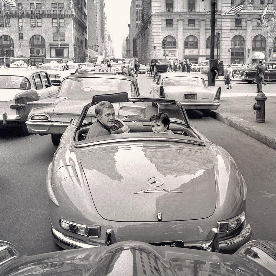 Steve McQueen driving convertible in new york