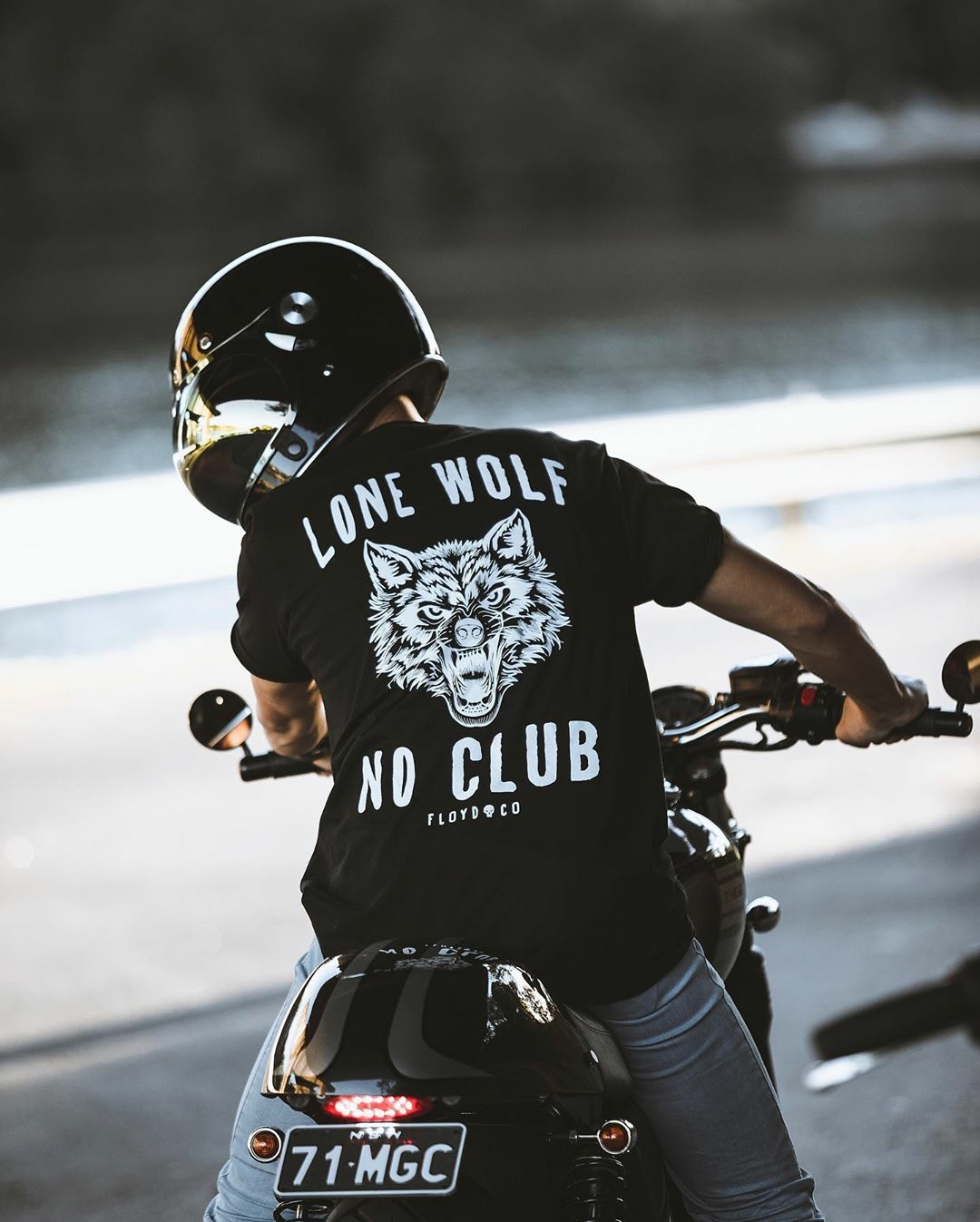 man riding motorcycle wearing lone wold no club t shirt