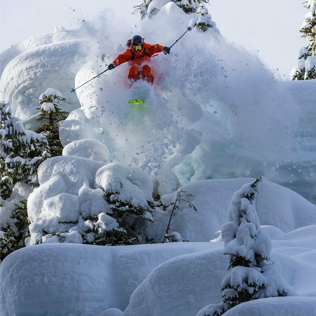 man skiing through deep snow