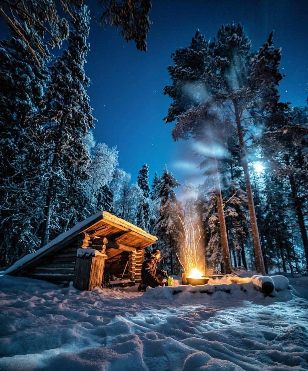 man tending fire near shelter