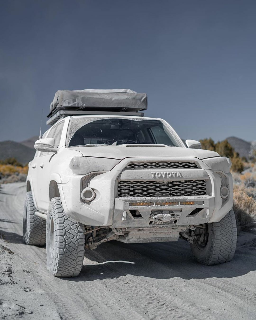 toyota truck covered in white dust