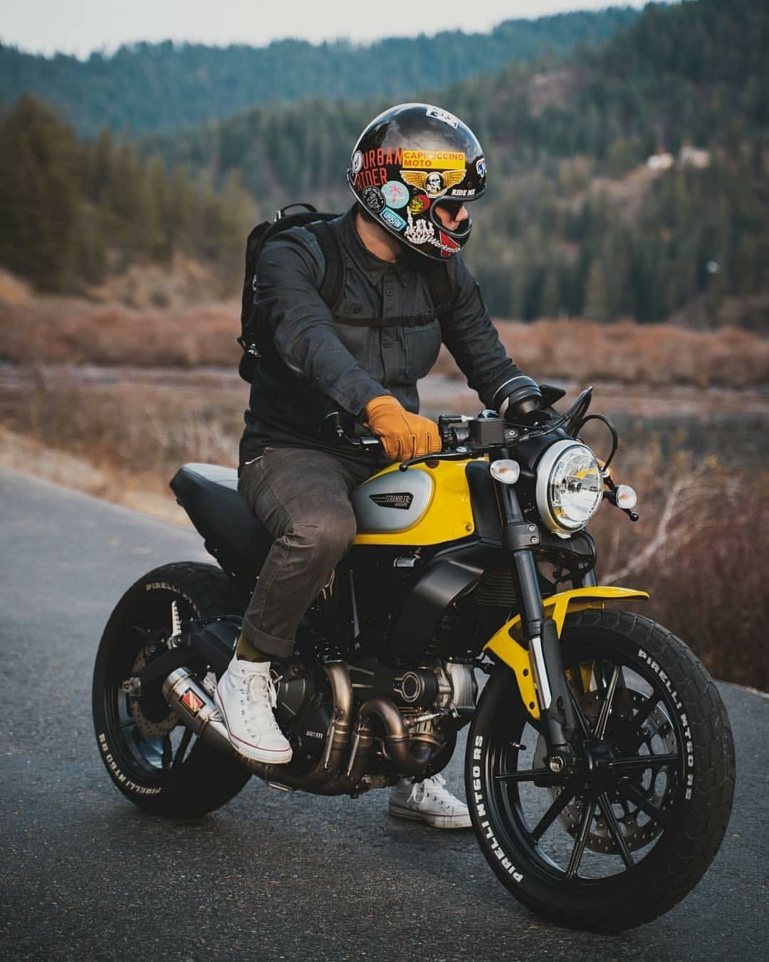 man riding yellow motorcycle
