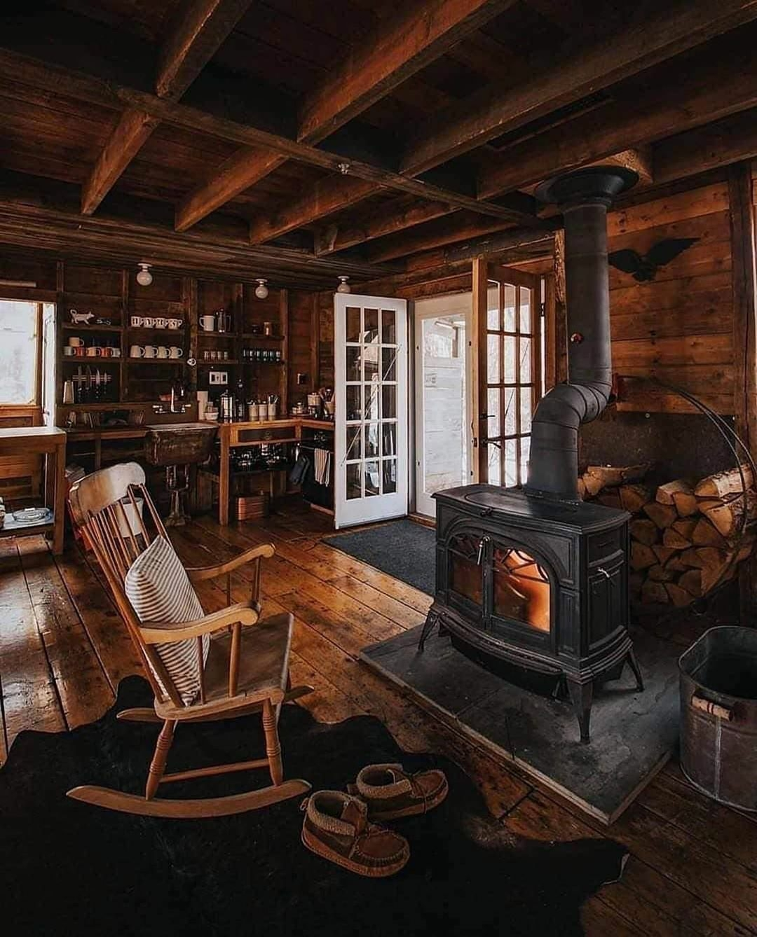 cabin interior with wood burning fireplace and rocker