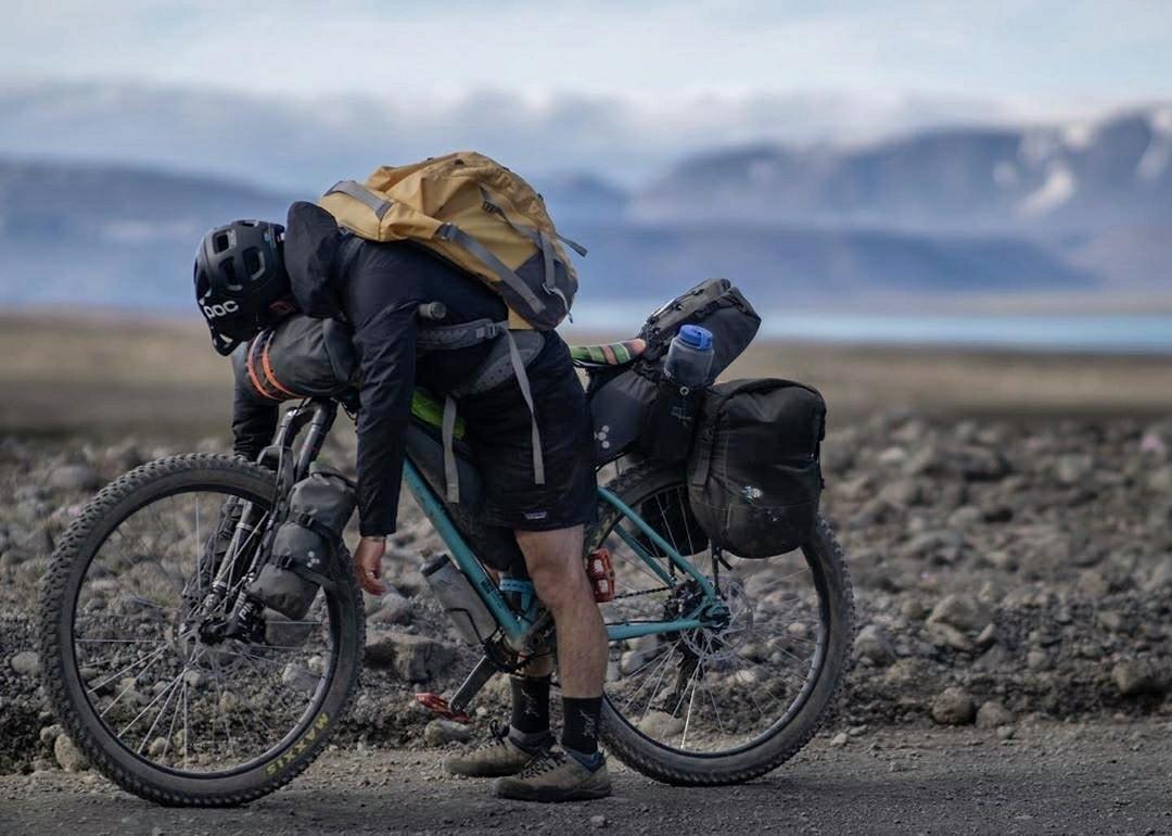 tired man resting on mountain bike