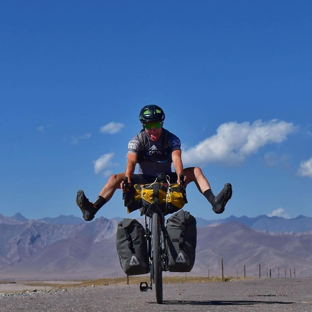man goofing around on bike