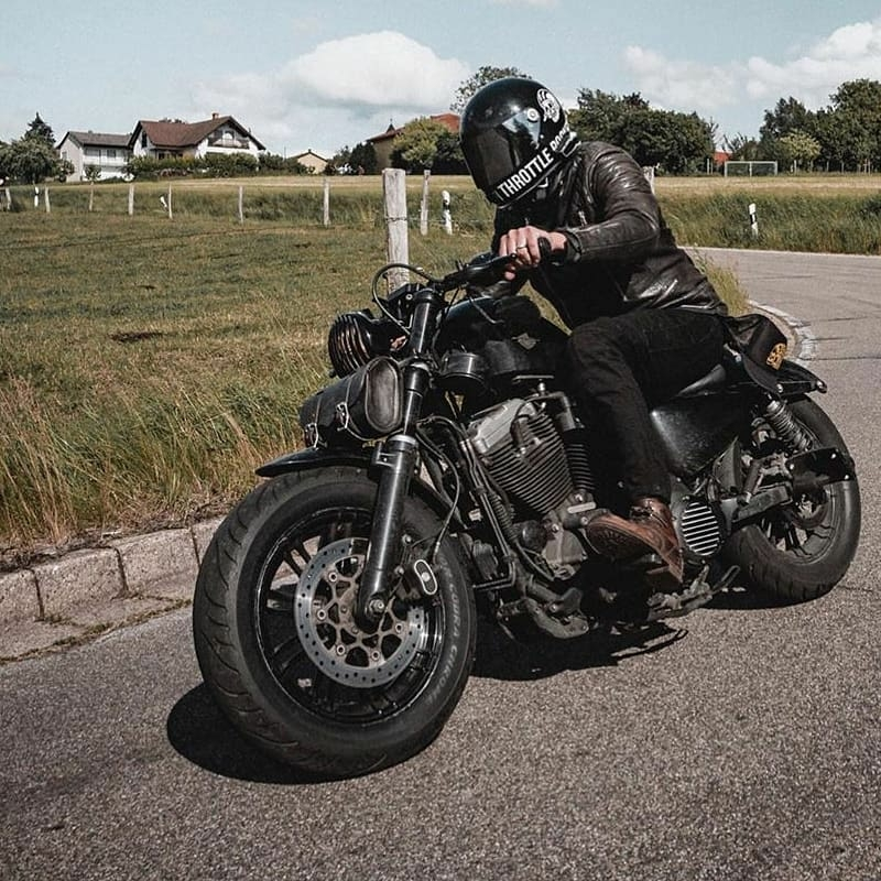 man riding black harley