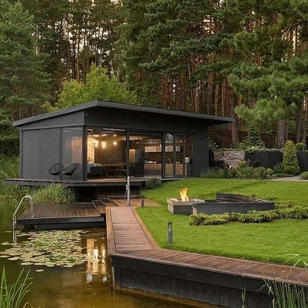 black cabin near pond