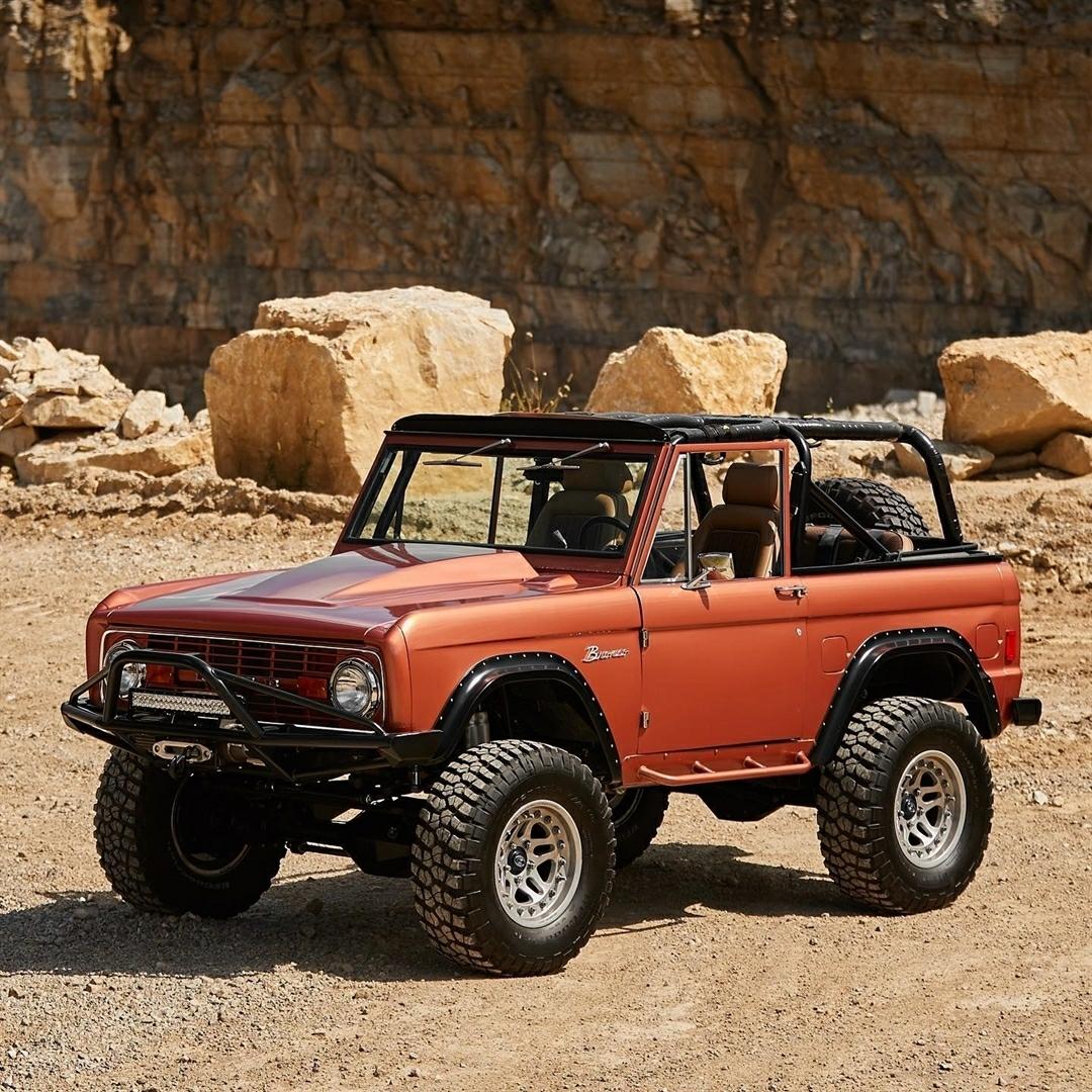 classic orange ford bronco in the desert