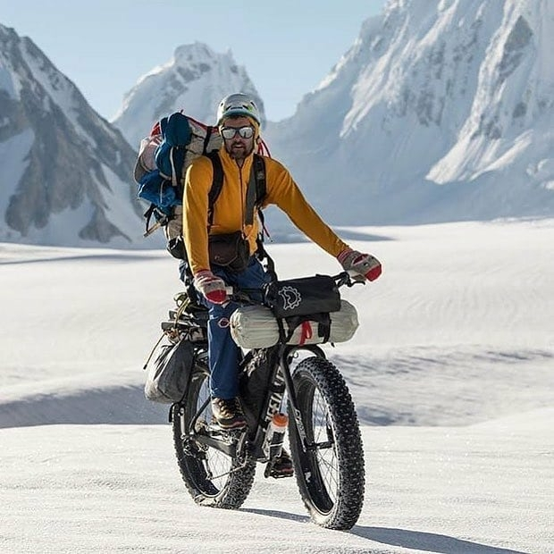 man riding fat tire mountain bike in the snow