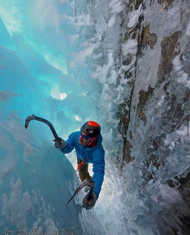 man ice climbing