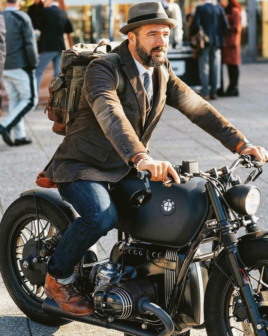 dapper gentleman on bmw motorcycle