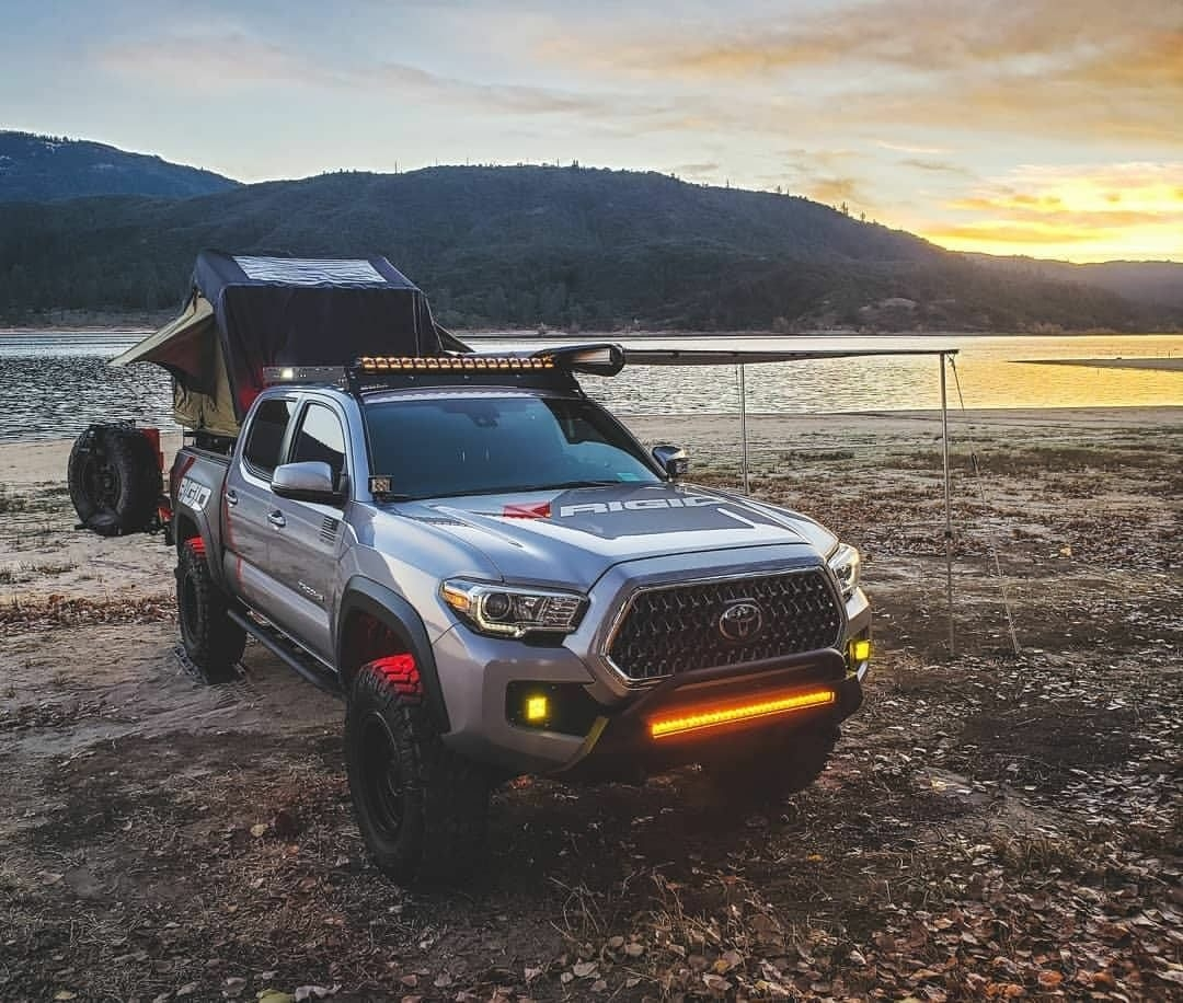 tacoma truck camper by lake