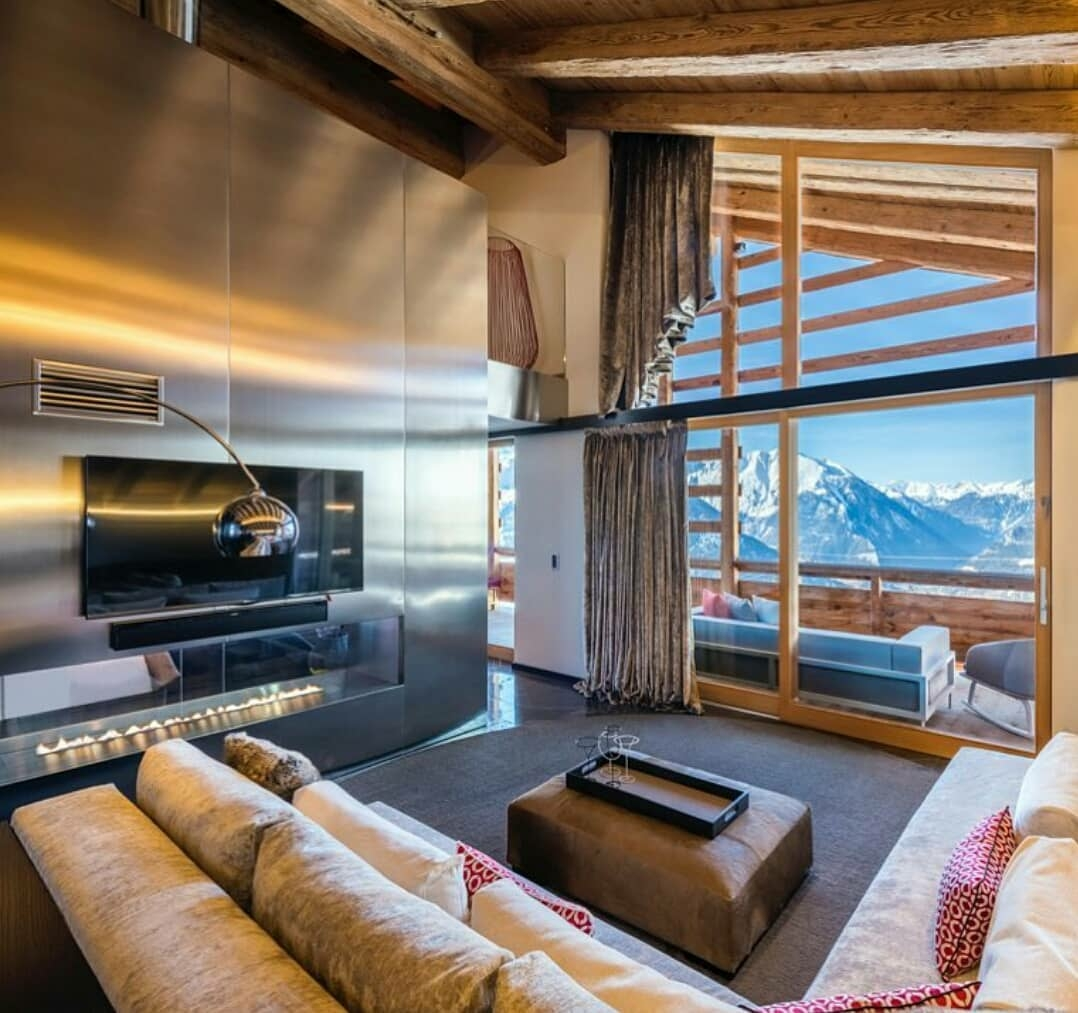 home with a stainless steel fireplace and a view