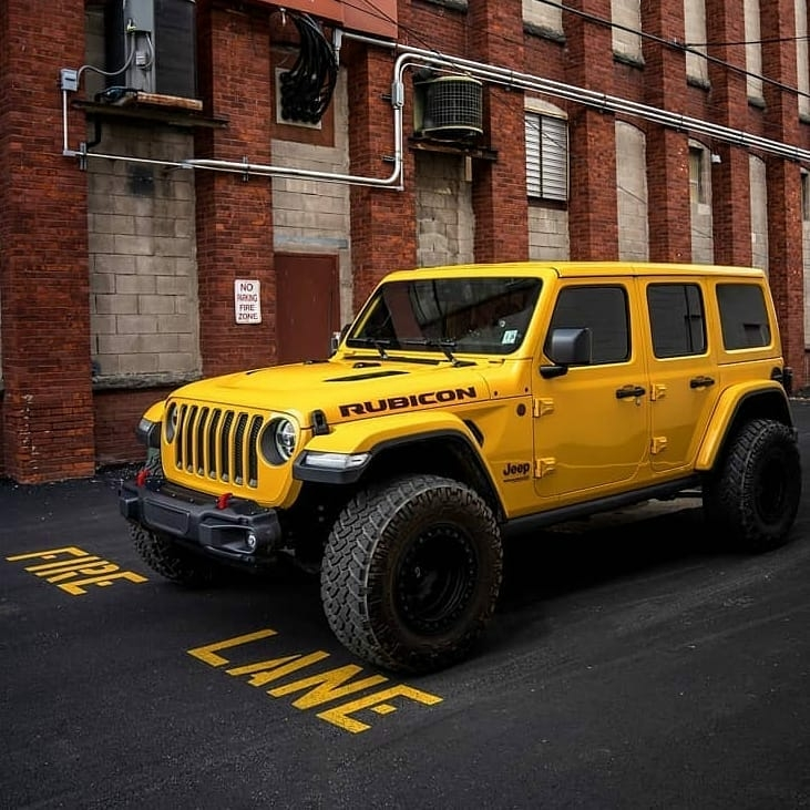 yellow rubicon in the city