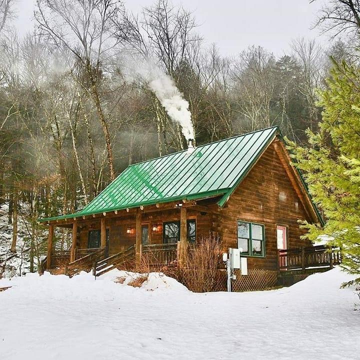 cabin snowy woods